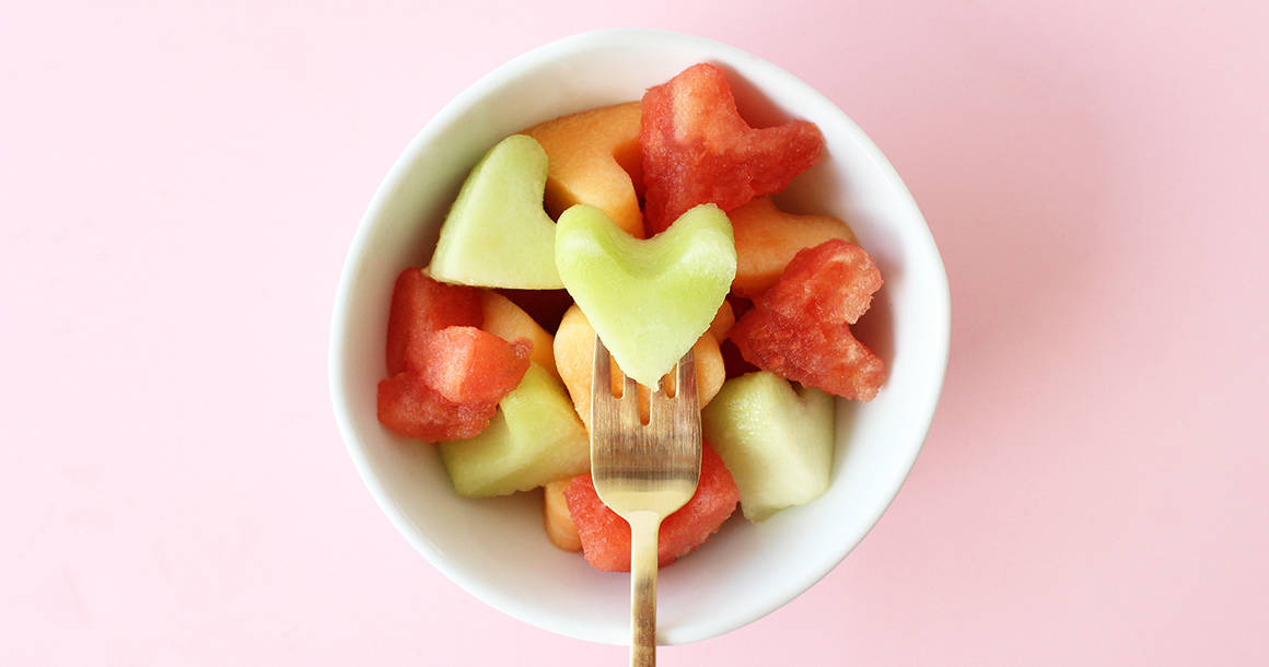 This is a recipe for Fruit Dip and Melon Heart Sticks by Glitter and Bubbles.