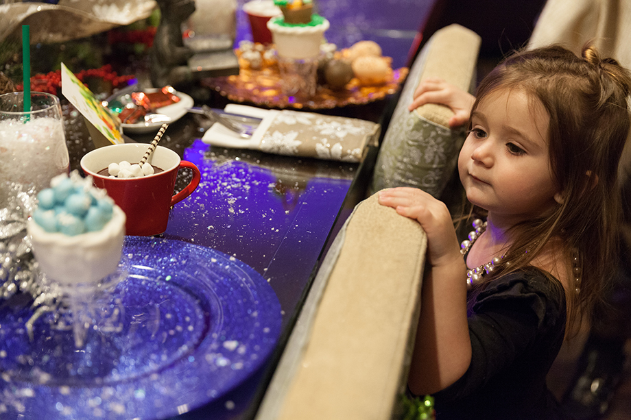 A little girl looks at a Christmas table at the Swissotel.