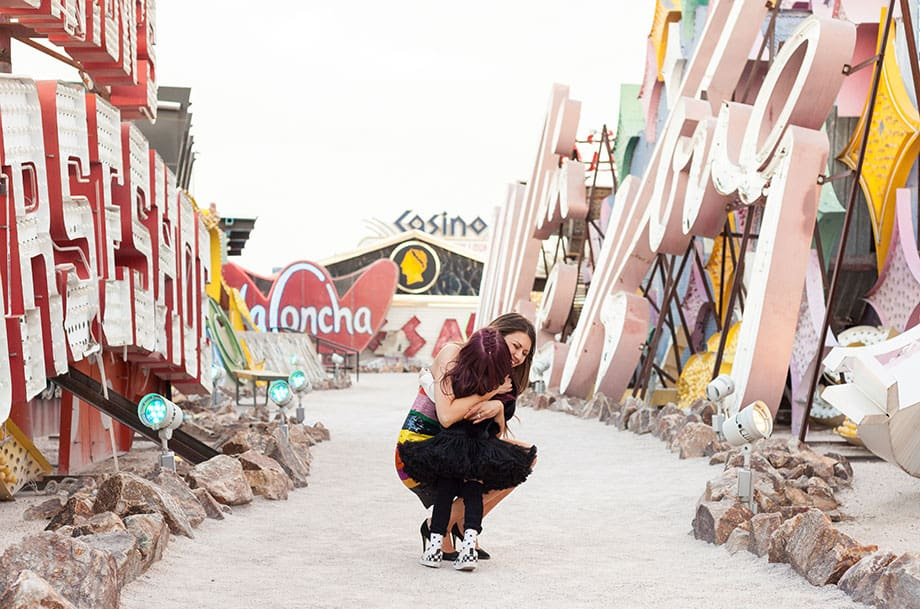 Zelda and Corri McFadden of Glitter and Bubbles hug at the Neon Museum in Las Vegas.