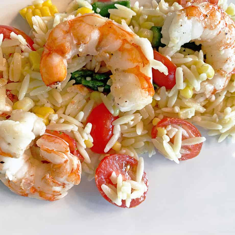A delicious summer salad recipe with shrimp and vegetables.