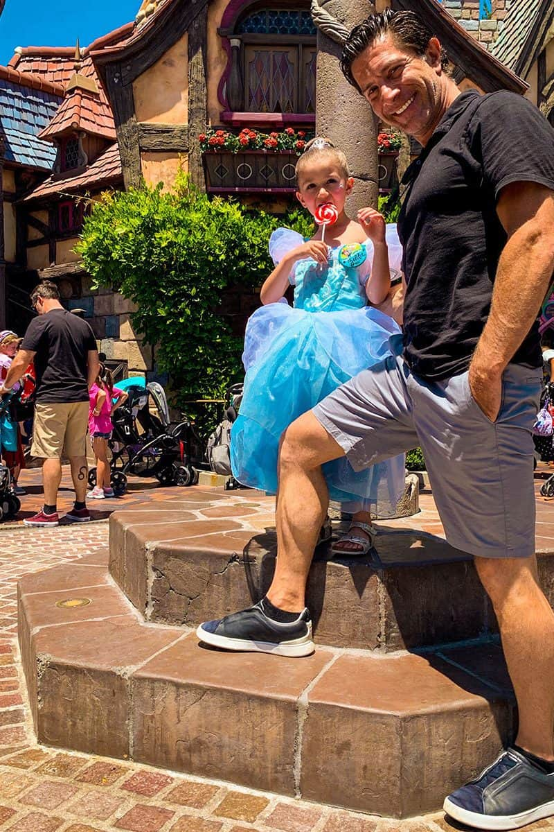 Zelda and her dad Spiro pose at Disneyland.