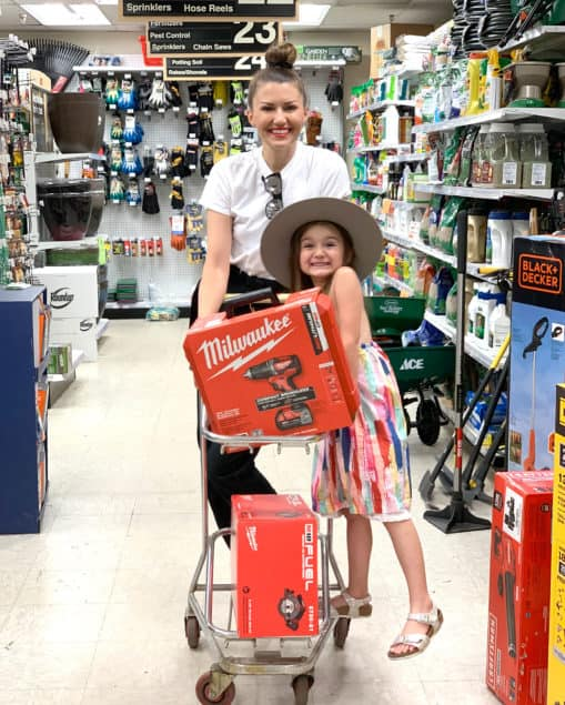 Corri & Zelda shopping at Ace Hardware for their DIY playhouse project.