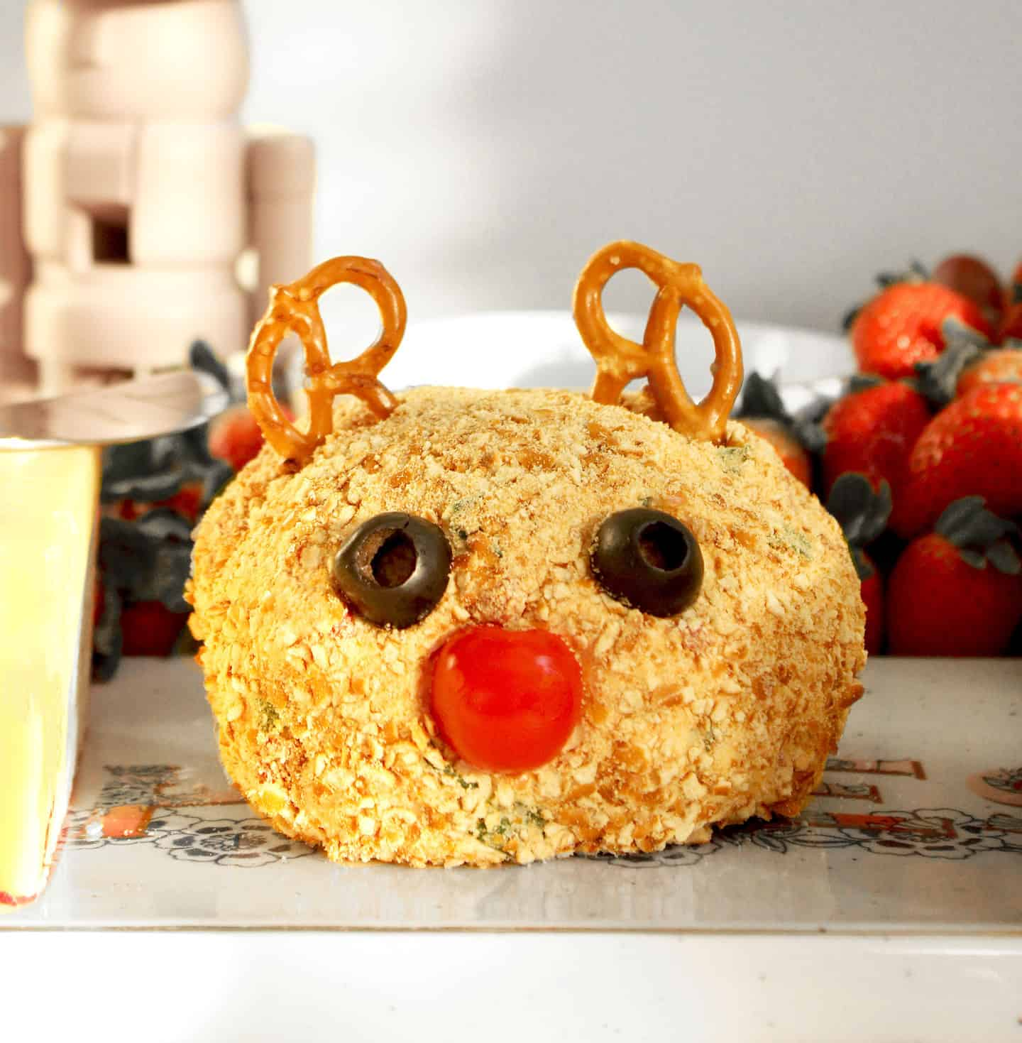 A Rudolph cheese ball on Glitter and Bubbles.